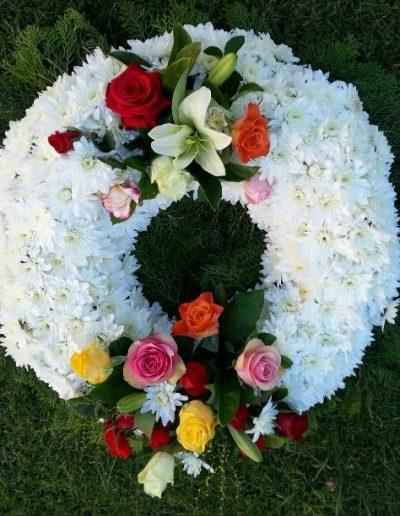 White wreath with coloured sprays